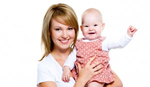 Woman with baby following weight loss and natural fertility treatment