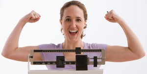 Happy Woman after losing weight on The HcG Diet